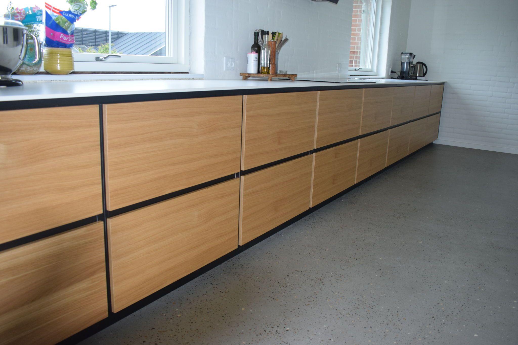 Langside af køkken efter køkkenrenovering